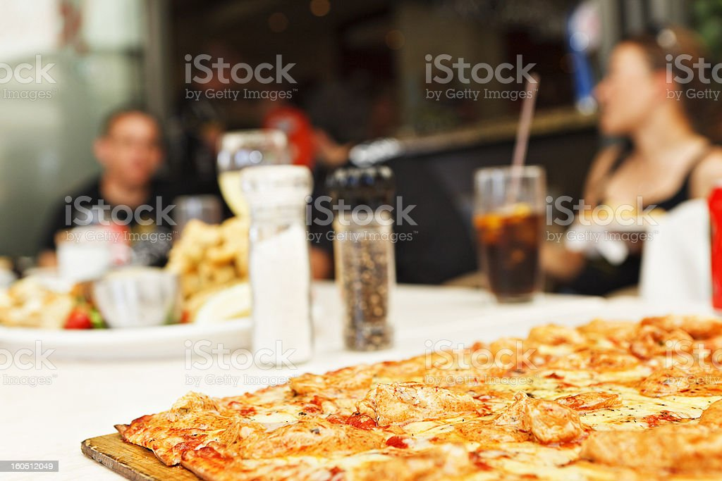 Pizza on a restaurant table royalty-free stock photo