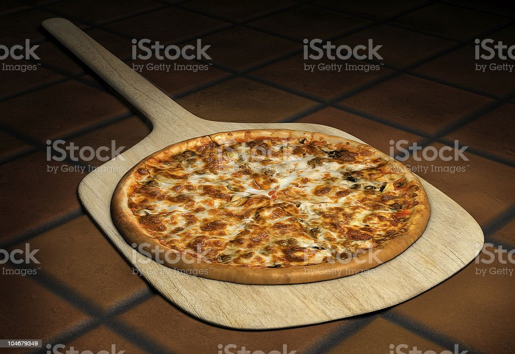 Pizza on a Wooden Peel stock photo
