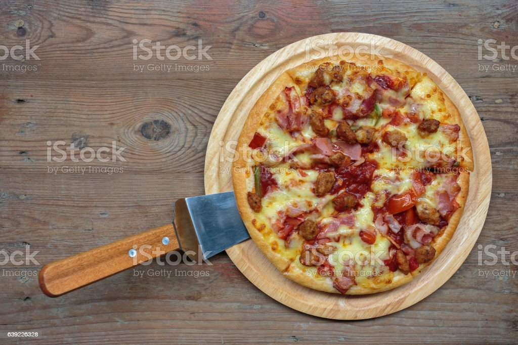 Pizza on a wooden tray. stock photo