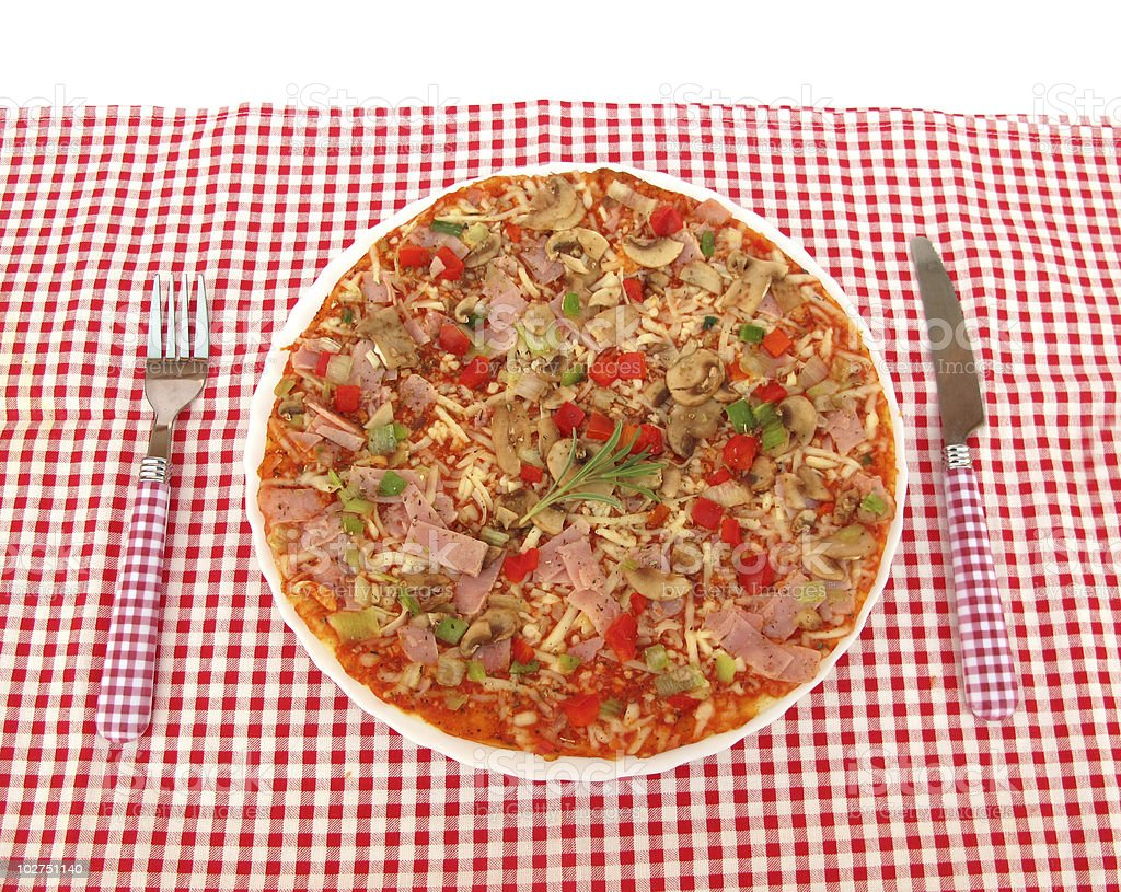 Pizza on table with red and white tablecloth royalty-free stock photo