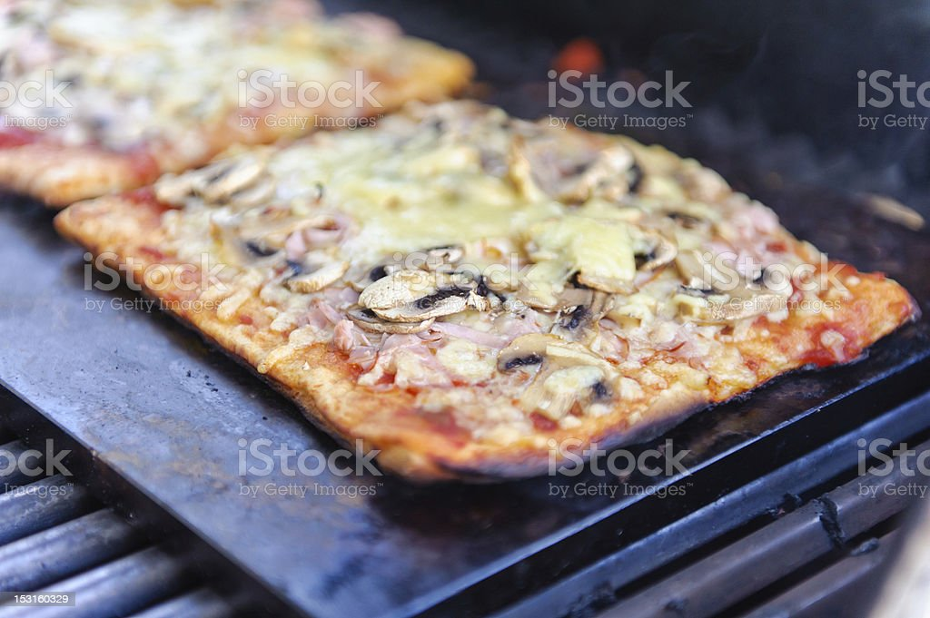 Pizza on the grill stock photo