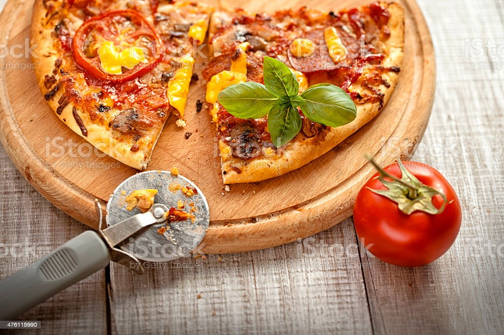 pizza on the wooden table stock photo