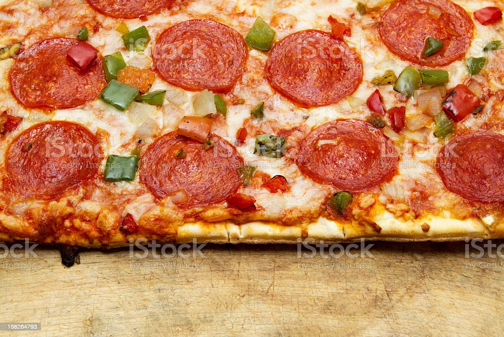 Pizza on wood royalty-free stock photo