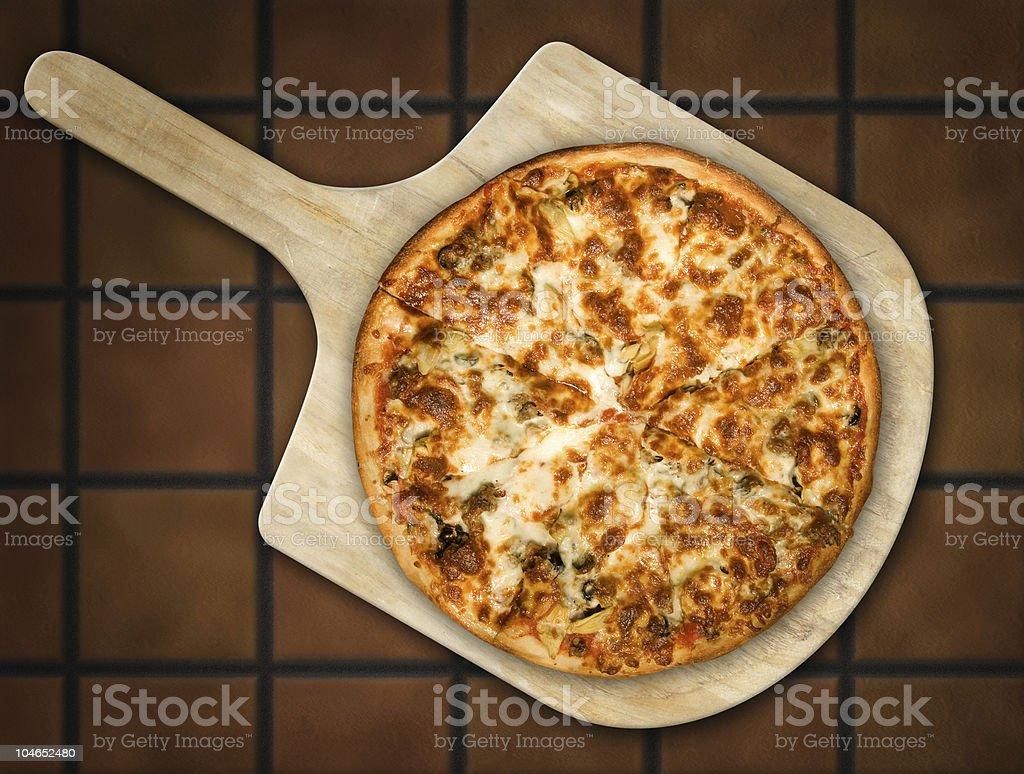 Pizza on Wooden Peel stock photo