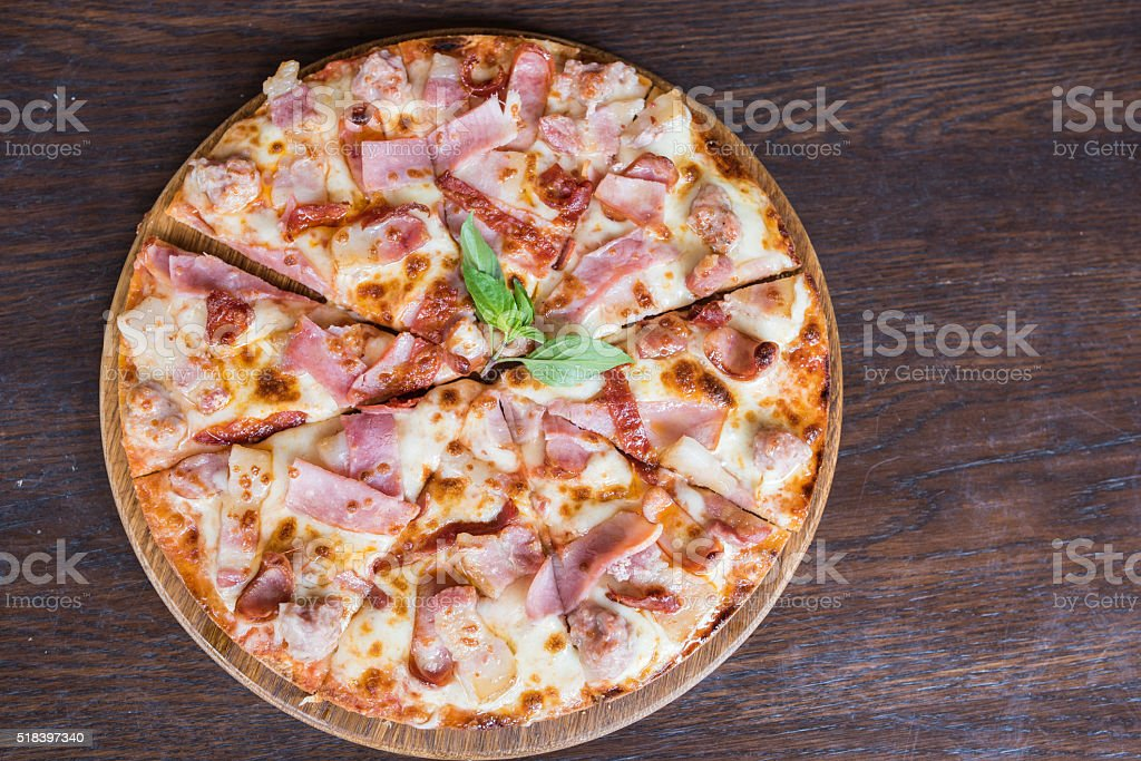 Pizza on wooden table, Top view stock photo