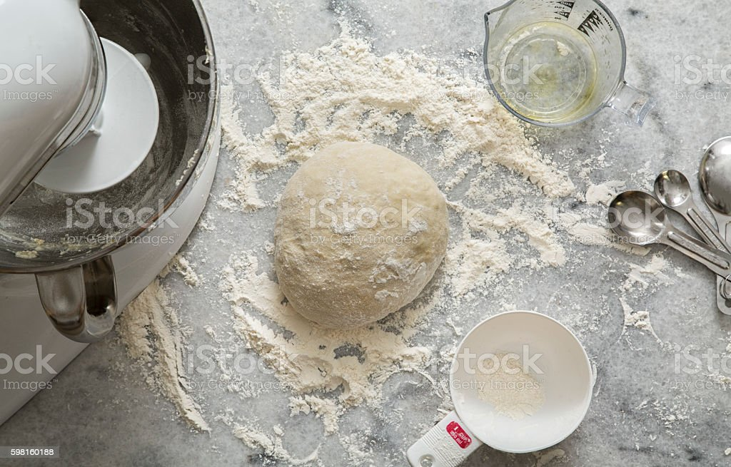 Pizza or Bread Dough Aerial View on Marble stock photo