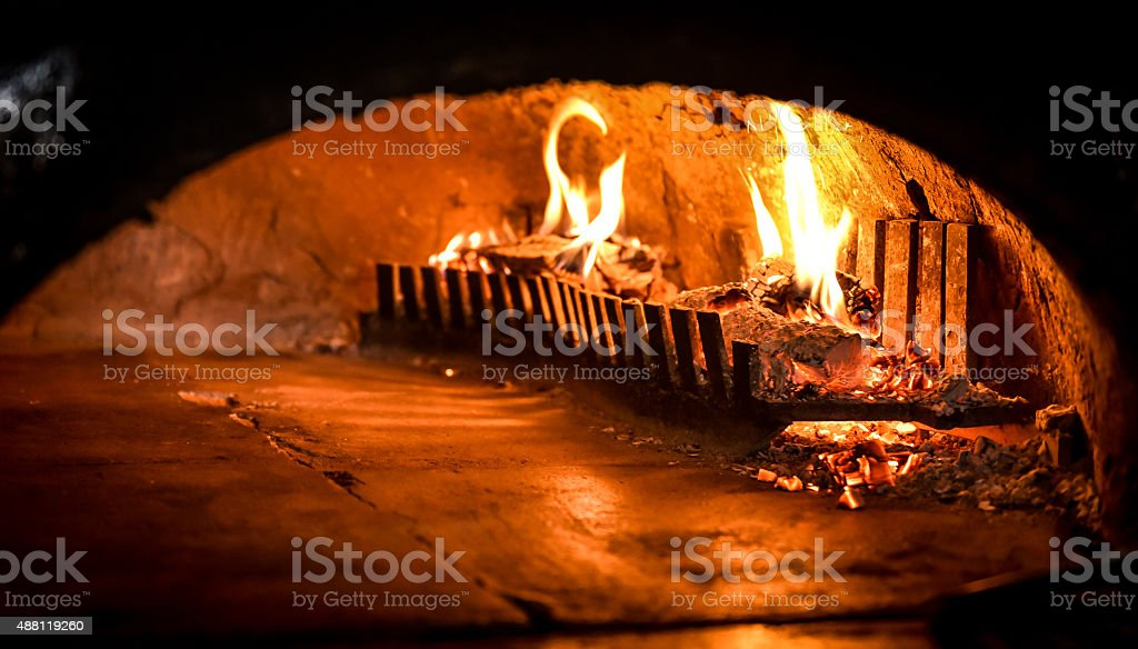 Pizza oven with natural firewood, coal and flame stock photo