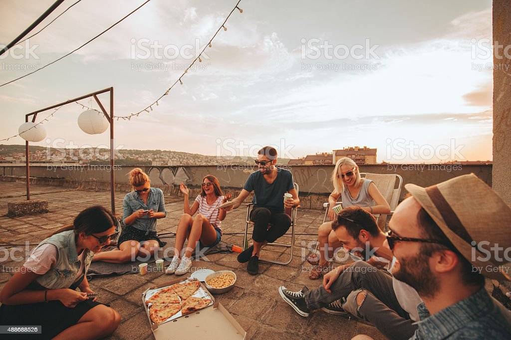 Pizza party on the roof stock photo