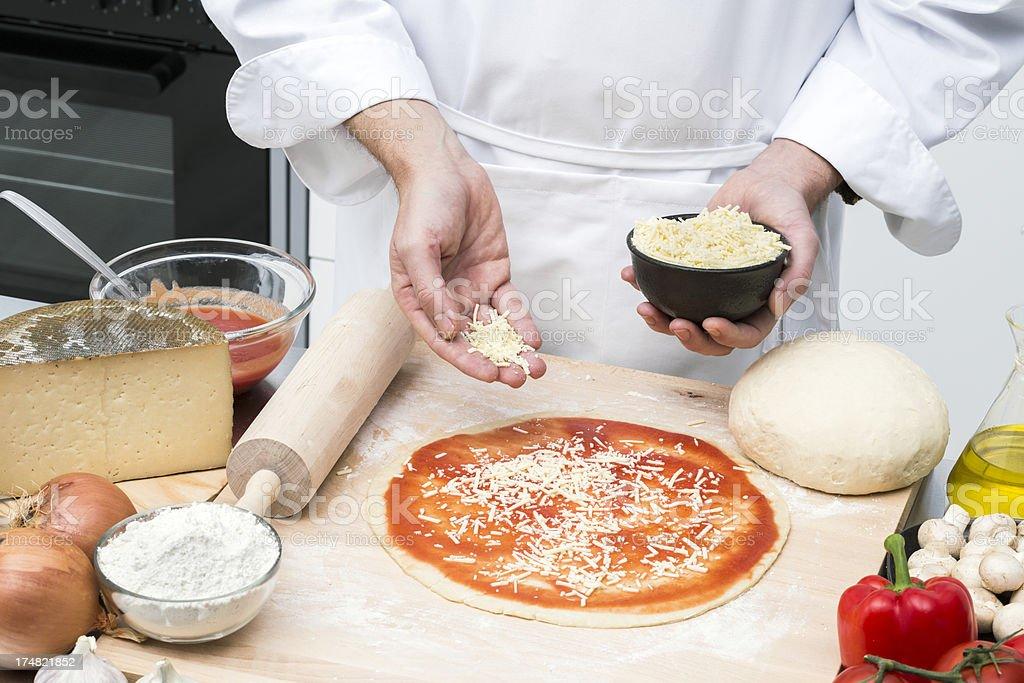 Pizza preparation royalty-free stock photo