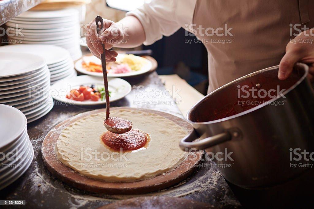Pizza preparation stock photo