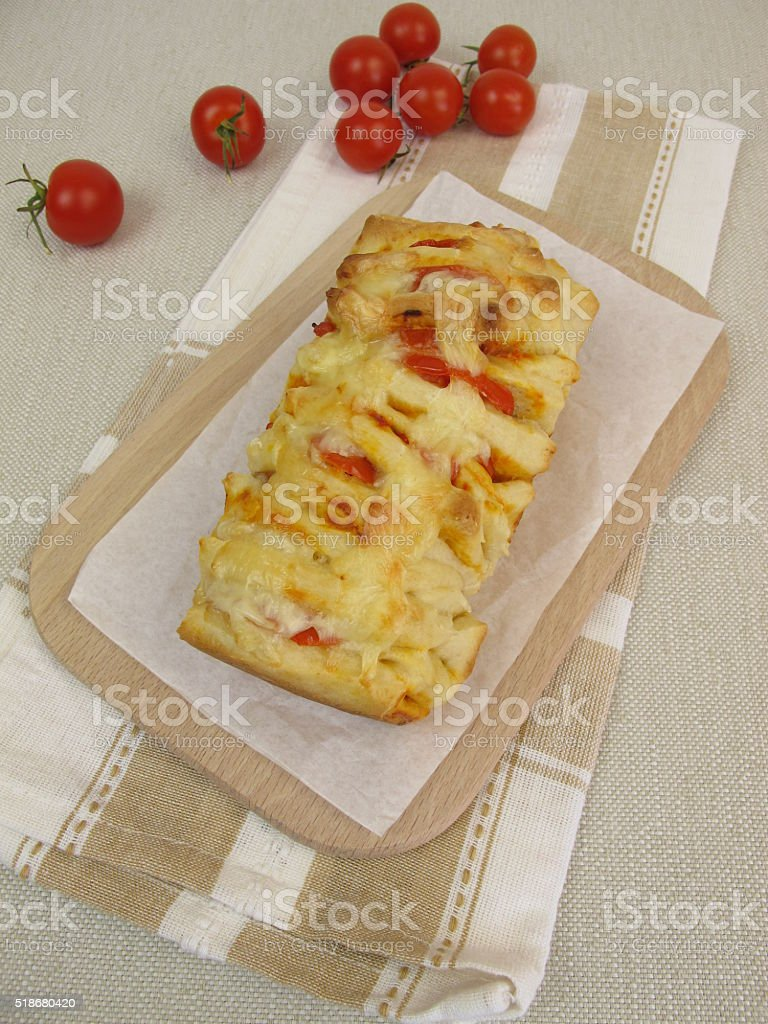 Pizza Pull-Apart-Bread with tomatoes and cheese stock photo