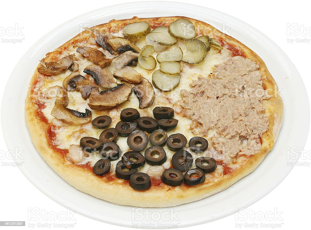 Pizza quattro stagioni with cheese tuna mushrooms and ham isolated stock photo