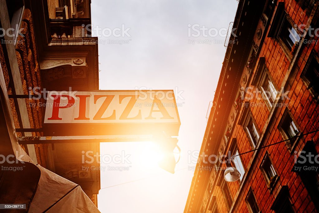 pizza restaurant in the town stock photo