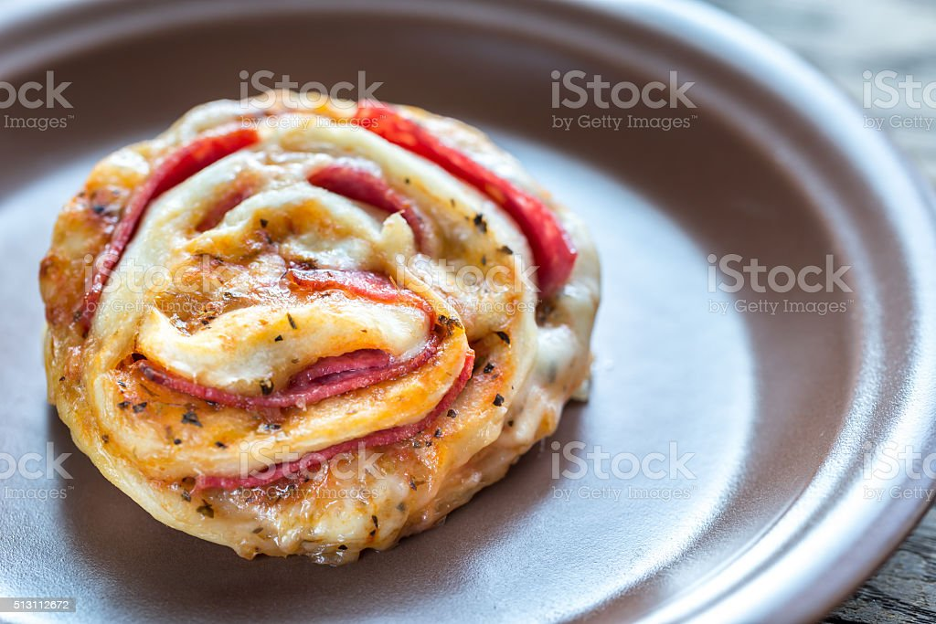 Pizza roll on the plate stock photo