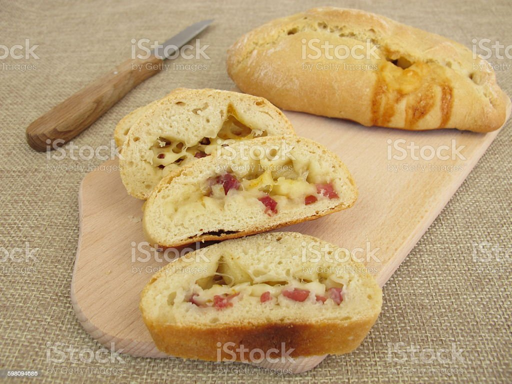 Pizza roll with cheese and ham stock photo
