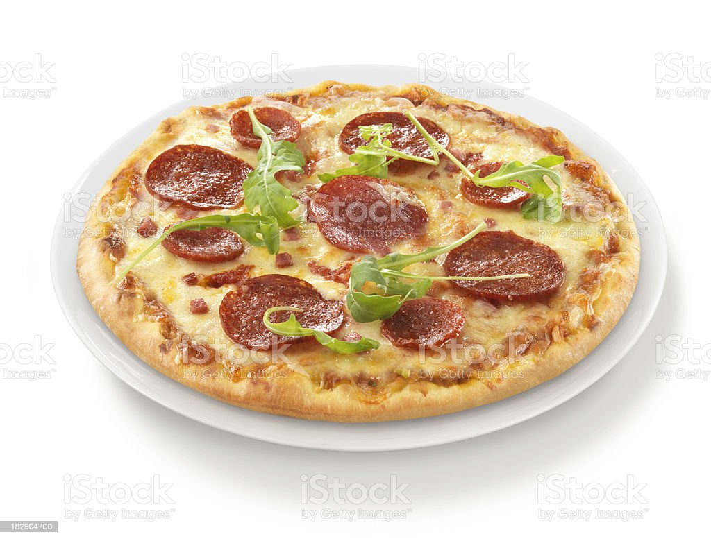 Pizza Salami Rocket on Plate stock photo