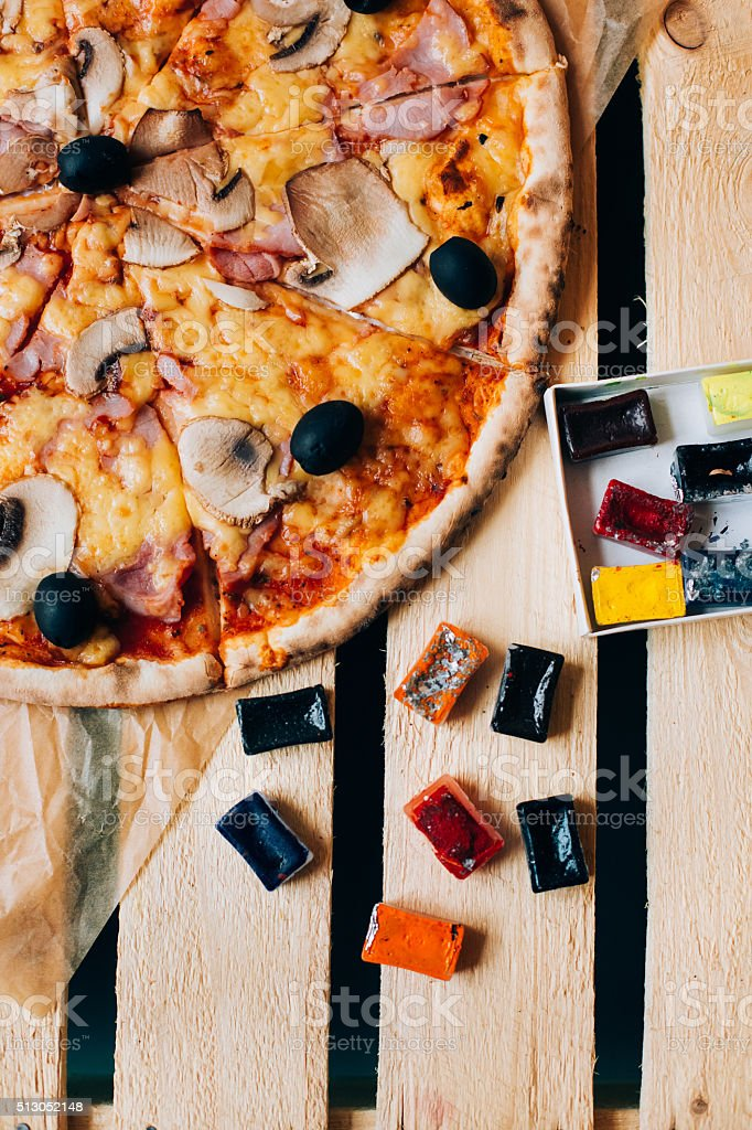 Pizza served on an wooden kitchen table. Food like arts stock photo