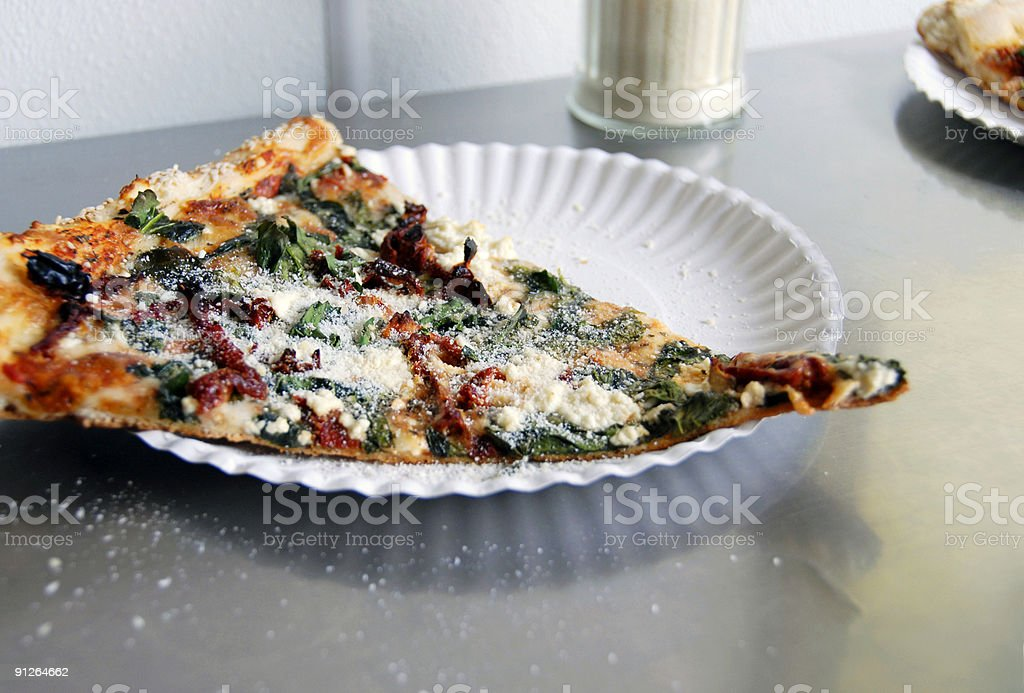 Pizza Slice on Paper Plate - Storefront Pizzeria stock photo