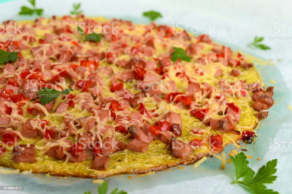Pizza - the basis of zucchini, ham and paprika. stock photo