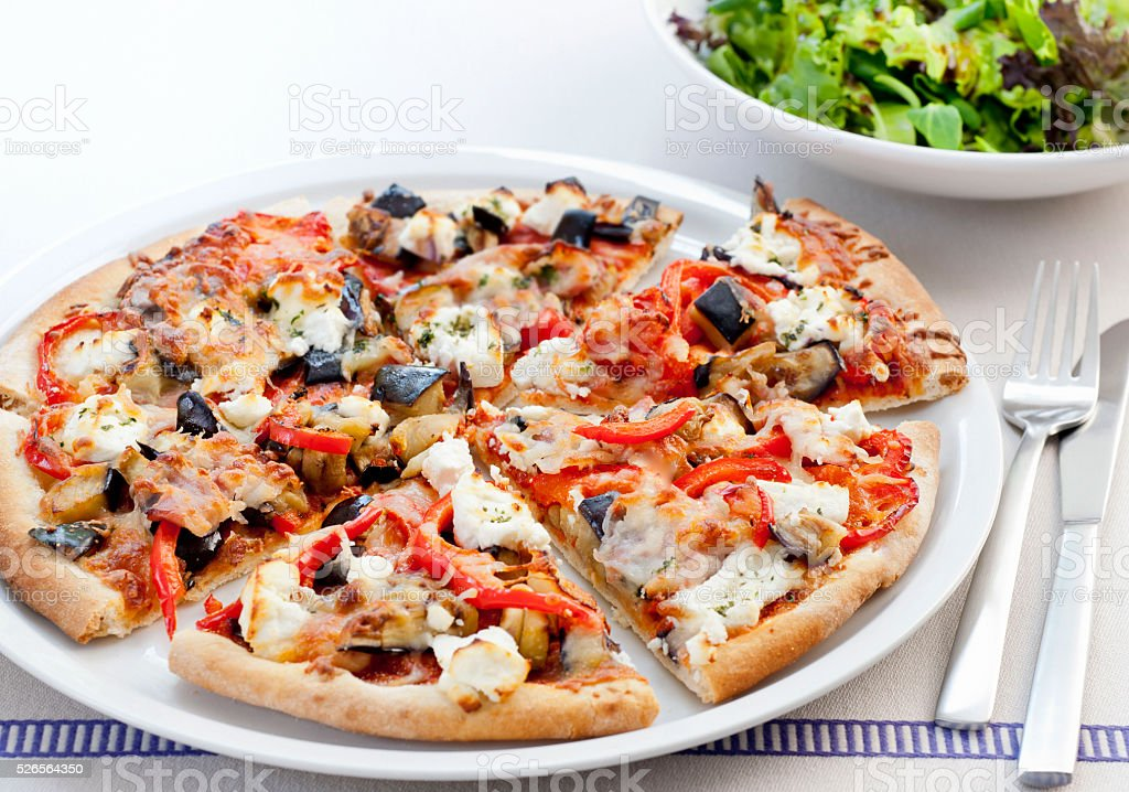 pizza topped with pancetta, goat cheese and vegetables stock photo