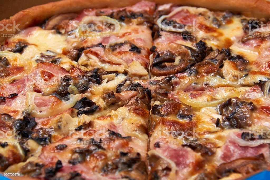 Pizza with Barbecue Chicken, Sausage, Bacon, Onions and Mushroom stock photo