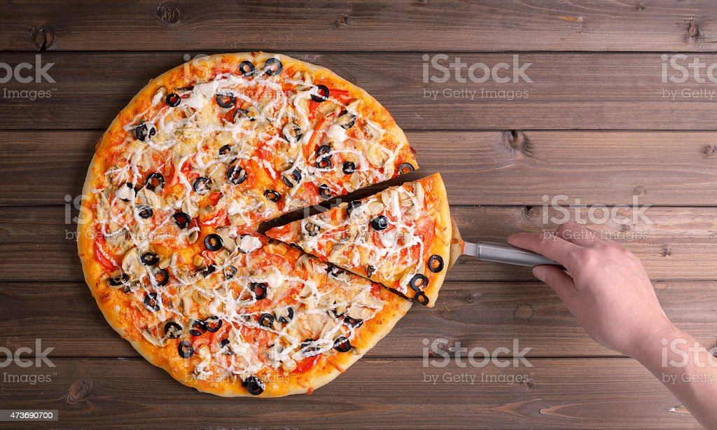 Pizza with cheese and pizza paddle stock photo