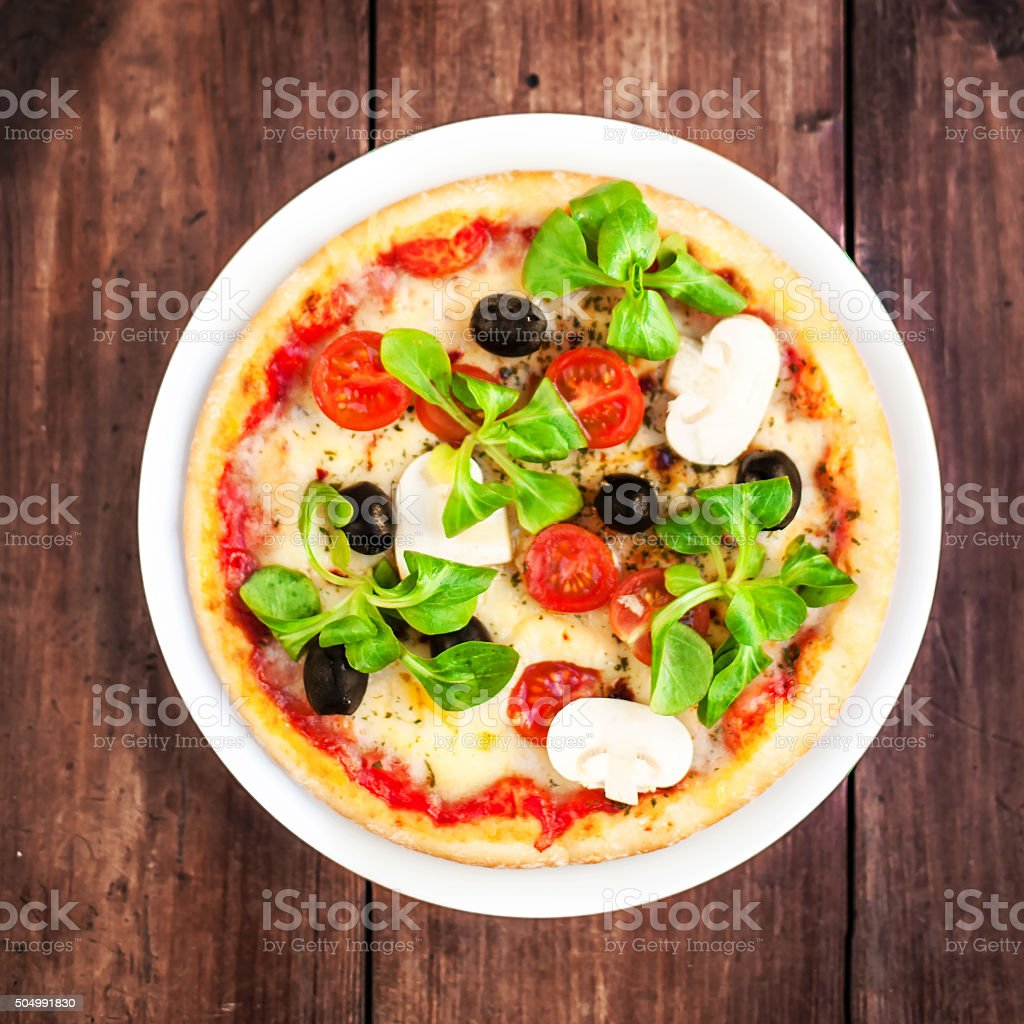 Pizza with cheese, mushrooms and olives, top view stock photo