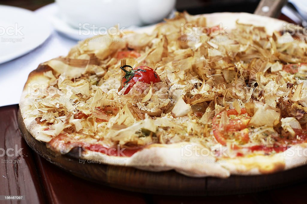 Pizza with cherry tomatoes and cheese royalty-free stock photo