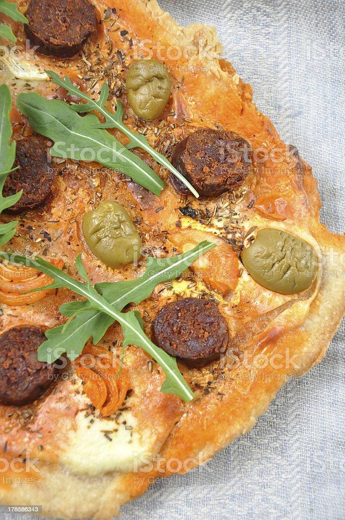 Pizza with Chorizo and olives royalty-free stock photo