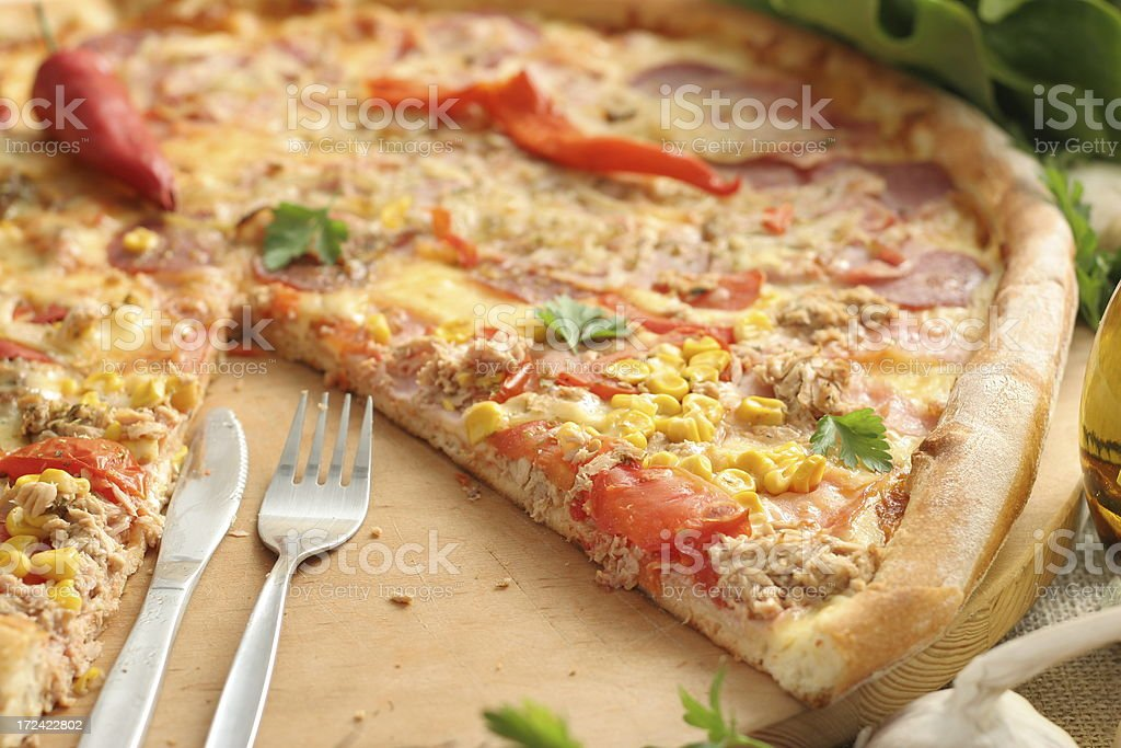 Pizza with cutlery royalty-free stock photo