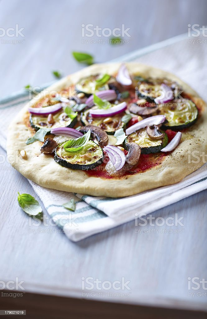 Pizza with grilled courgette, mushrooms and pine nuts royalty-free stock photo