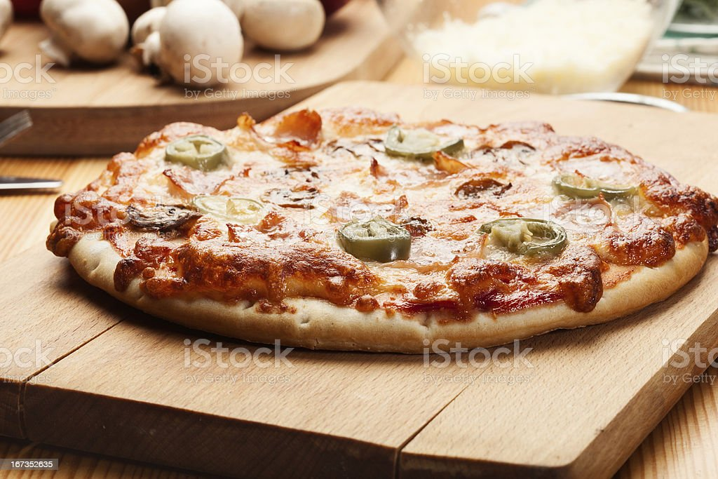 Pizza with ham and cheese royalty-free stock photo