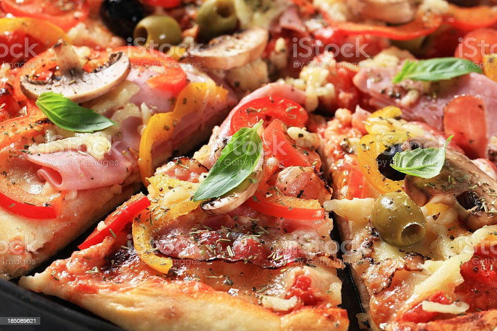 Pizza with ham and mushrooms royalty-free stock photo