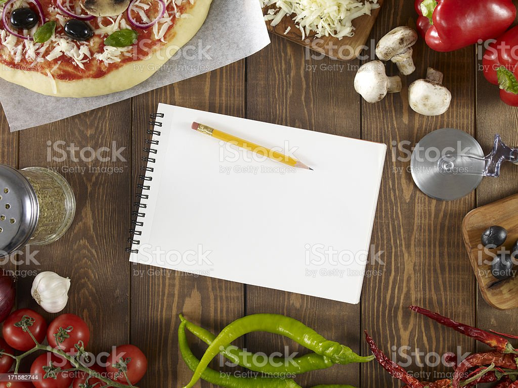 Pizza With Ingredients And Notebook stock photo