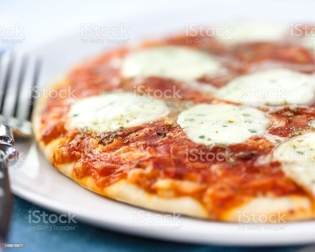 Pizza with mozzarella and tomato sauce royalty-free stock photo