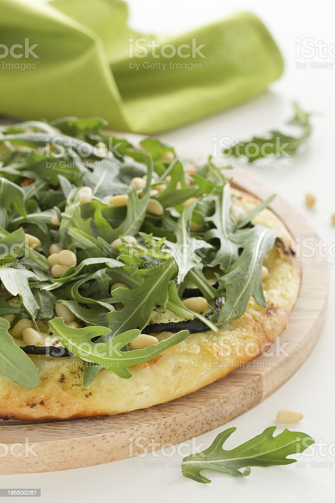 Pizza with mozzarella cheese, arugula and nuts. royalty-free stock photo