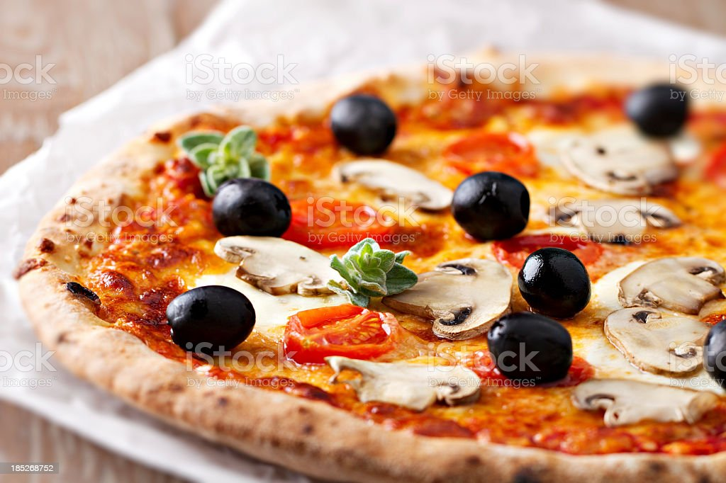 Pizza with mushrooms and olives stock photo