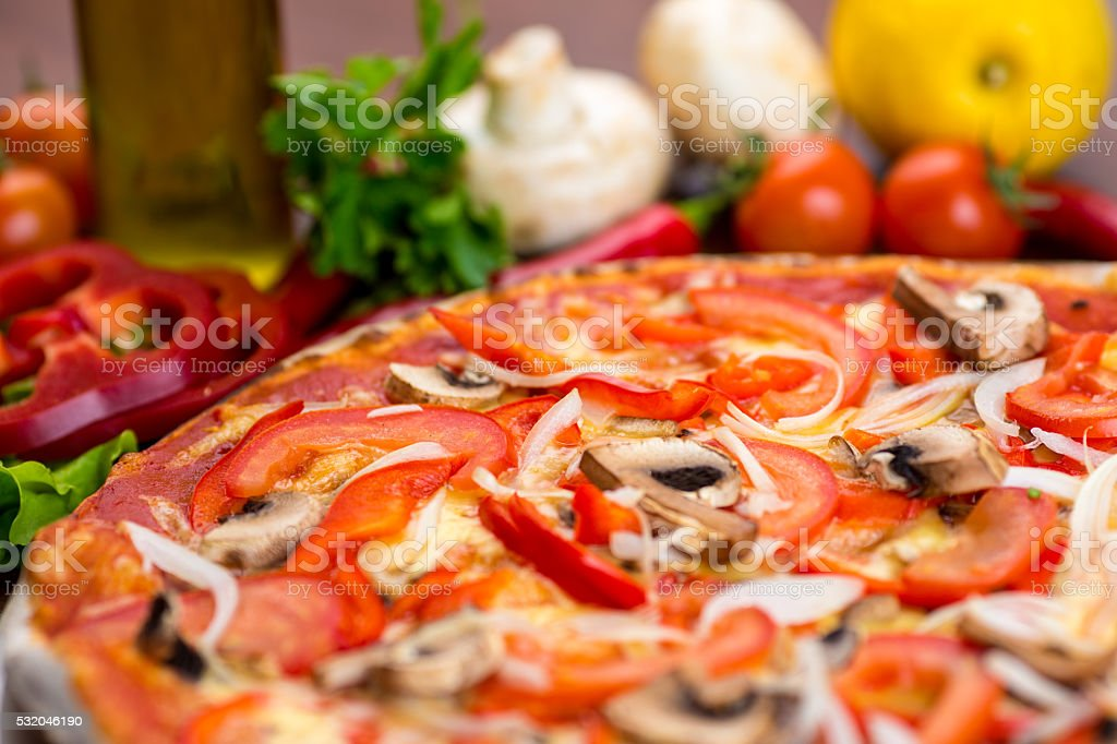 Pizza with mushrooms on table stock photo