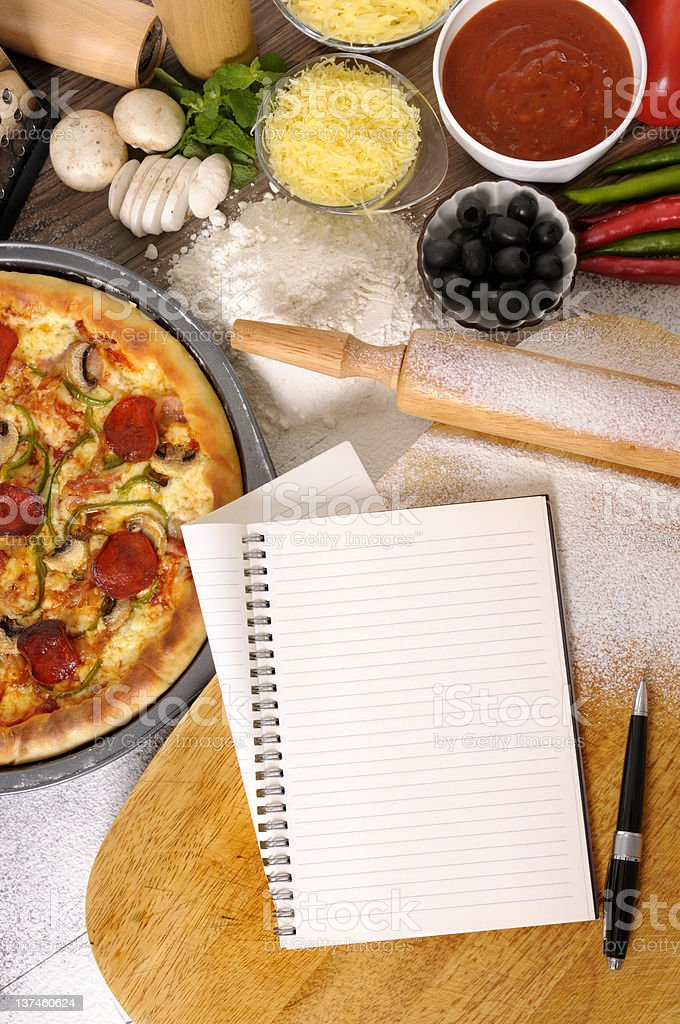 Pizza with notebook royalty-free stock photo