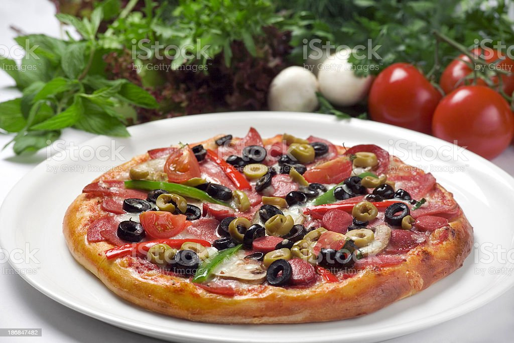 Pizza with pepperoni,mushrooms,sausage,tomatoes royalty-free stock photo
