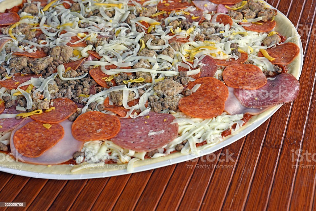 Pizza With Pork Toppings royalty-free stock photo