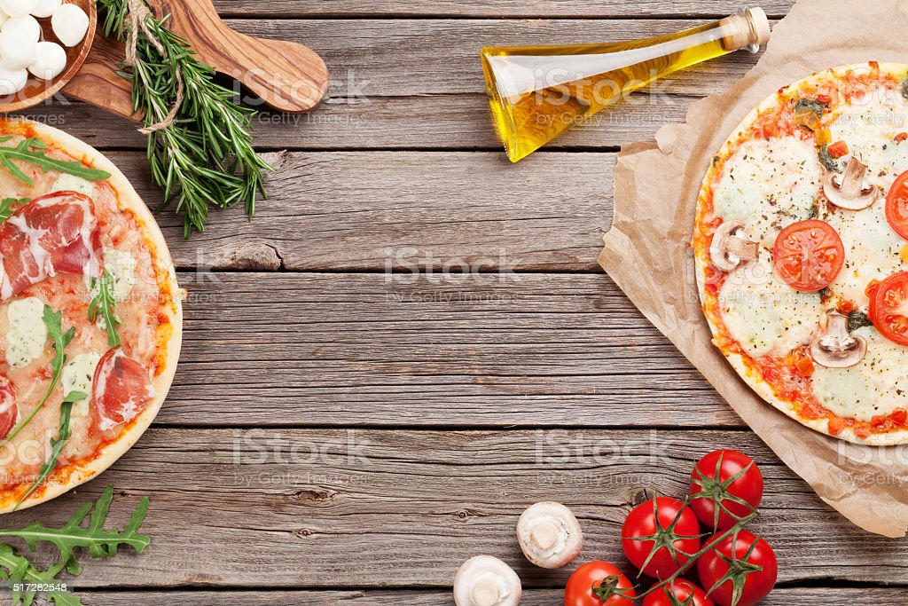 Pizza with prosciutto and tomatoes stock photo