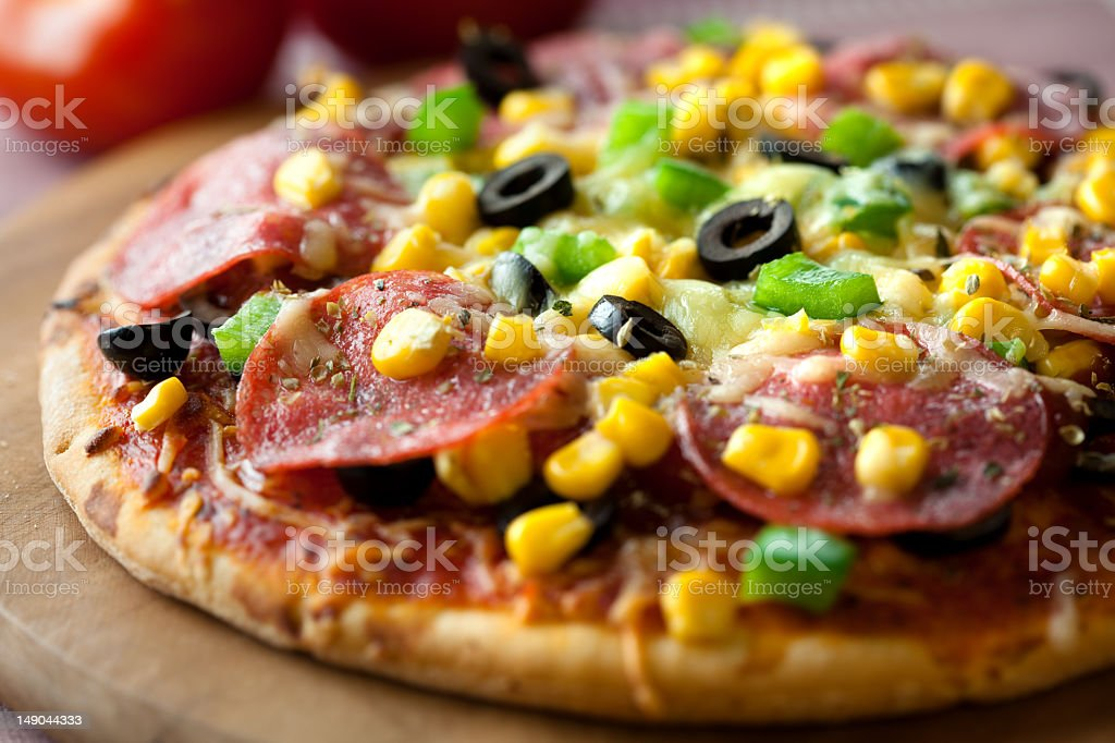 Pizza with salami royalty-free stock photo