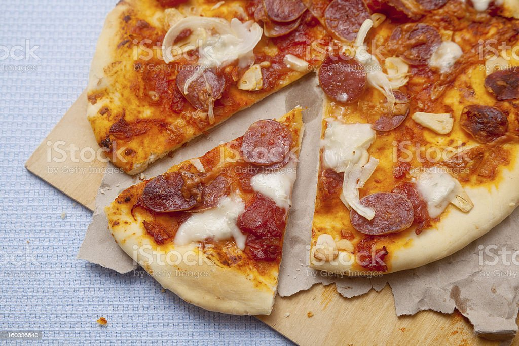 Pizza with sausage and onion royalty-free stock photo