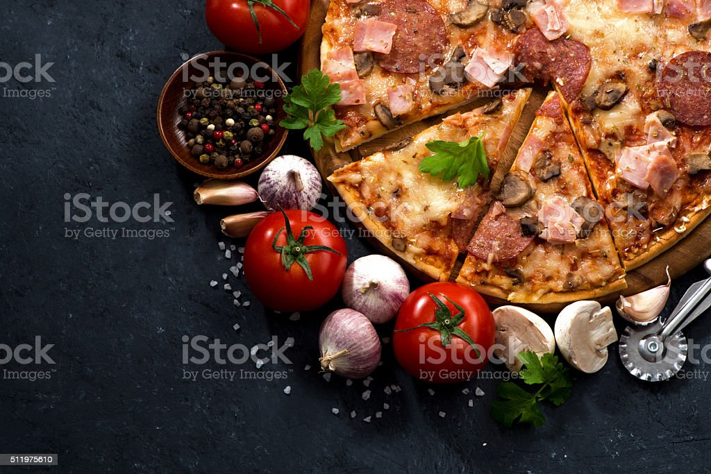 pizza with sausage, cheese and ingredients, top view stock photo