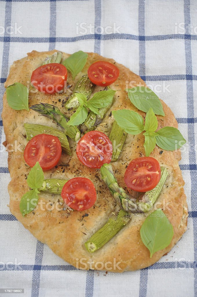 Pizza with tomatoes and green asparagus royalty-free stock photo