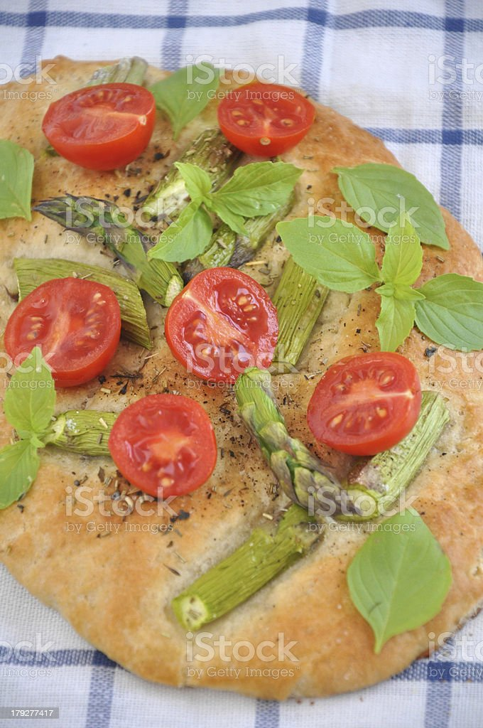 Pizza with tomatoes and green asparagus stock photo