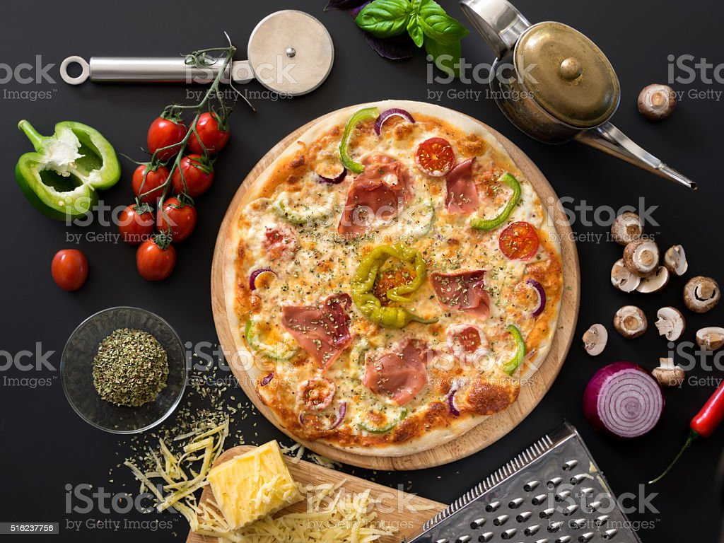 Pizza with tomatoes, cheese, basil and ham royalty-free stock photo