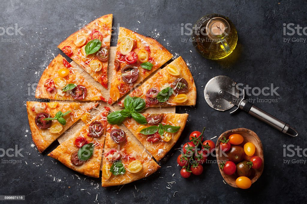 Pizza with tomatoes, mozzarella and basil stock photo