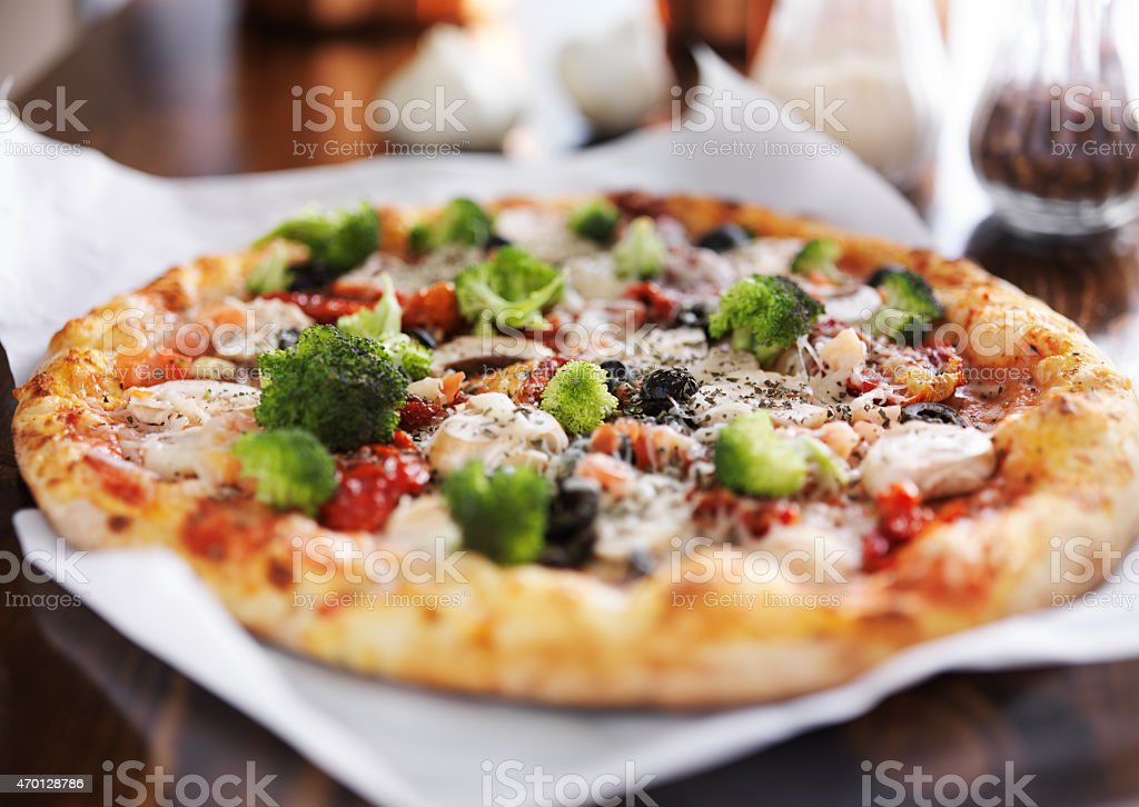 pizza with vegan friendly cheese and vegetables stock photo